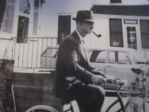 Grandpa on my brother's bike back in the 50's with his signature pipe in his mouth. He inspired the name of the Senior initiative: Grandpa's Express